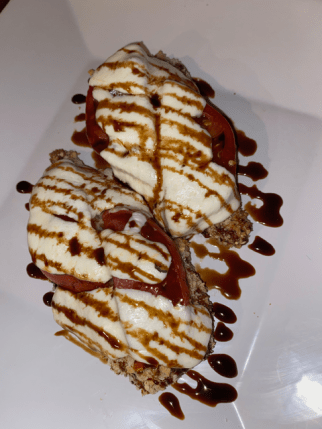Chicken caprese is a breaded chicken cutlet with tomato slices, melted mozzarella cheese, and a beautiful drizzle of balsamic glaze. This is my most cooked chicken leftover idea.
