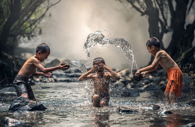 Children bath in the river - stay healthy