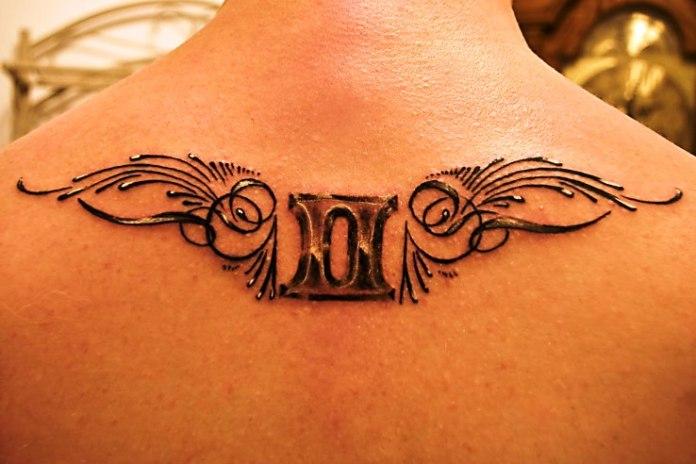 zodiac gemini tattoo on upper back