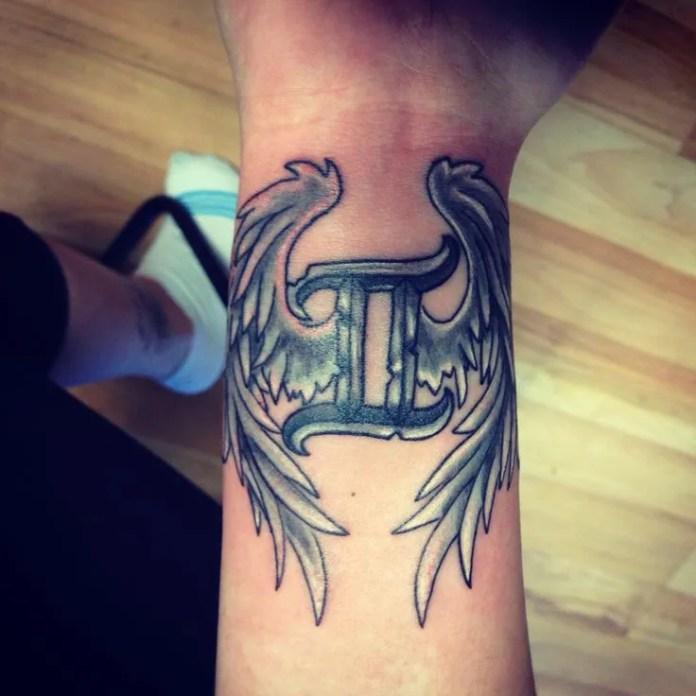 gemini tattoo with wings in wrist