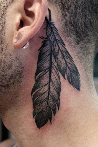 ear behing maori tattoo