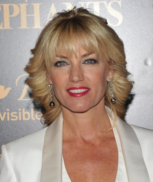bangs blonde hairstyle for women over 50