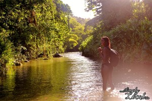 Girl backpacking in Rio grande river valley Jamaica