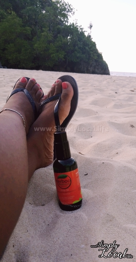 manicured toes on the beach with herboo body oil