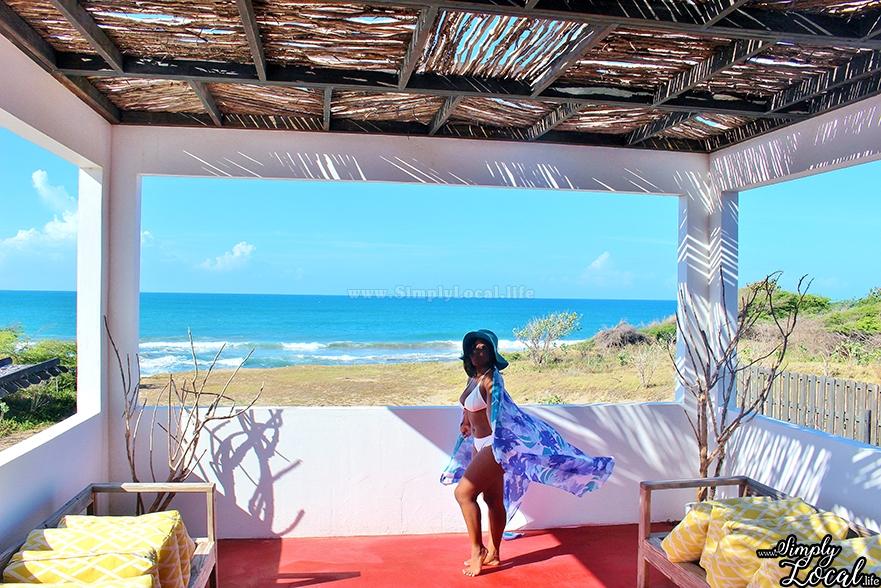Turtles Nest Treasure Beach Jamaica Villa woman with sarong flowing beach