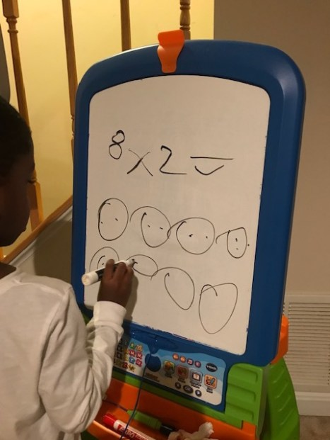 My son is three-years-old. He was curious about multiplication after seeing the x sign. I showed him how to complete multiplication problems through drawing pictures.