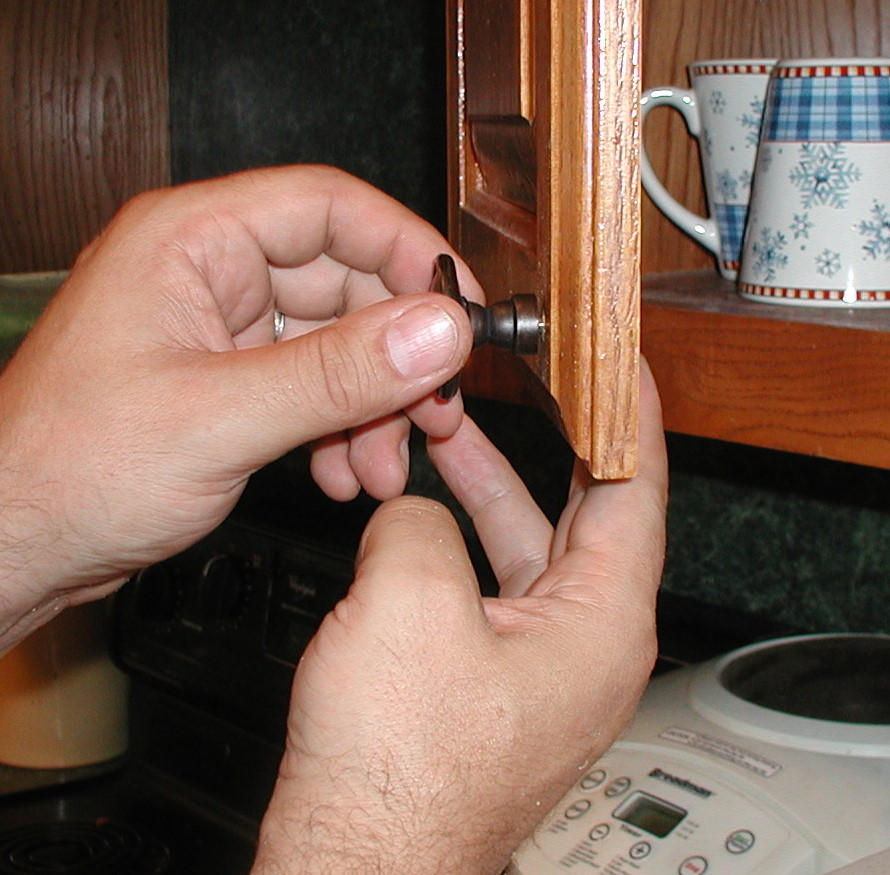 screwing on cabinet knob