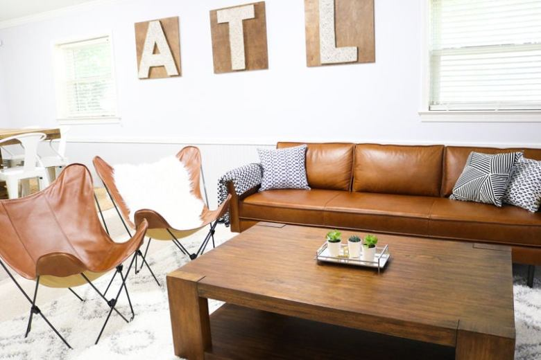 brown leather sofa in living space