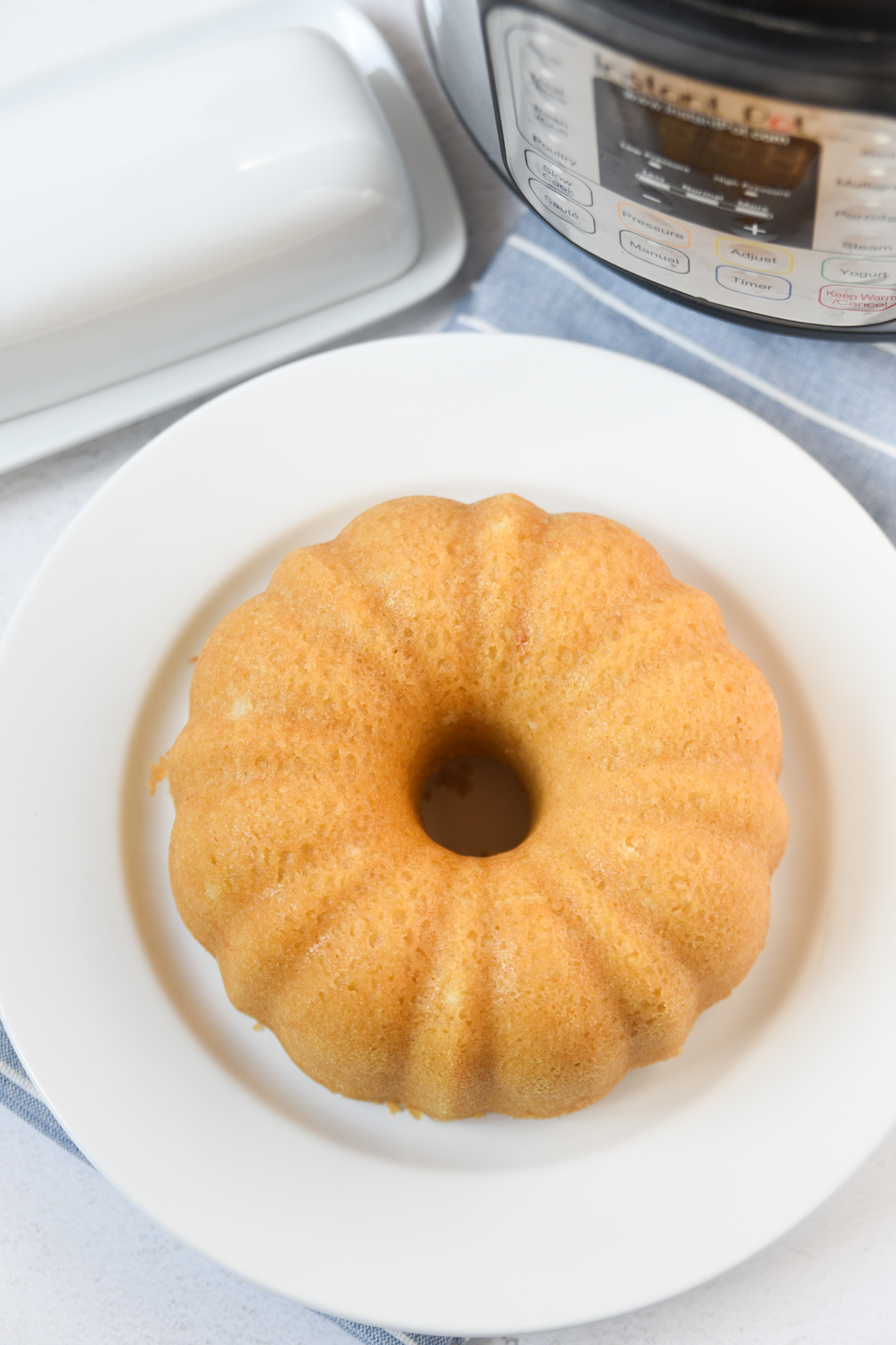 instant pot cornbread in bundt pan on a white plate