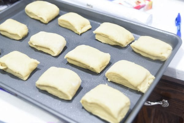 placing rolls on pan