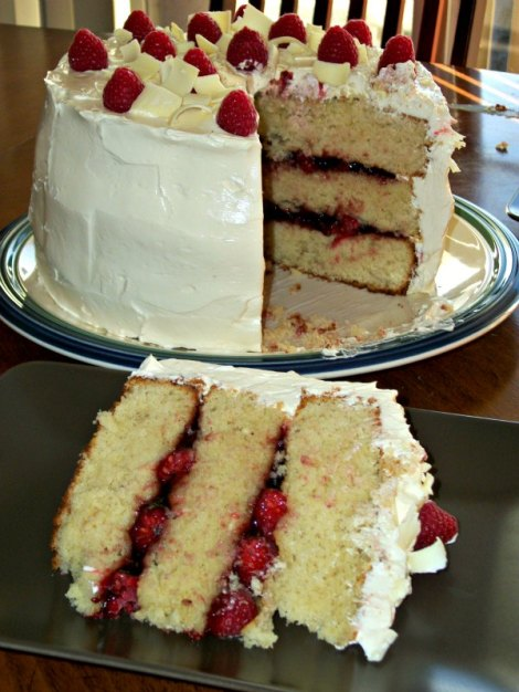 Whole White Chocolate Cake with Slice Removed