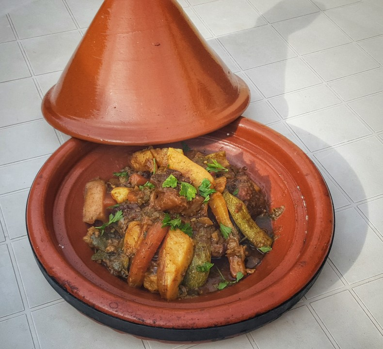 Moroccan Beef Tagine, served in a tagine pot.