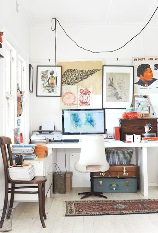 Vintage Suitcases Under The Desk // 12 Creative Spaces for the Organized Artist // simplyspaced.com