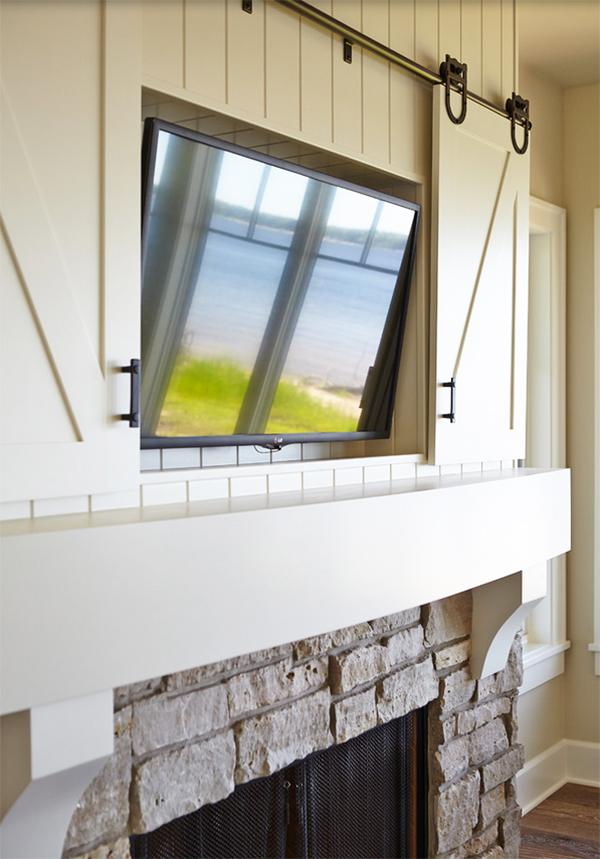 Hidden Flat Screen Television Behind Sliding Barn Doors // Storage Solution: Hidden Flat Screen Television // simplyspaced.com