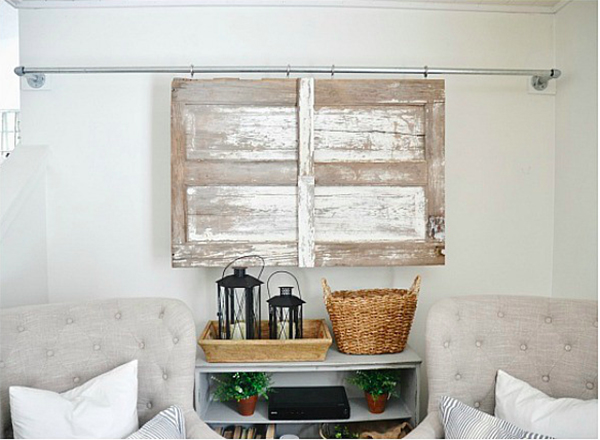 Hidden Flat Screen Television Behind Sliding Barn Doors // Storage Solution: Hidden Flat Screen Television // simplyspaced.com