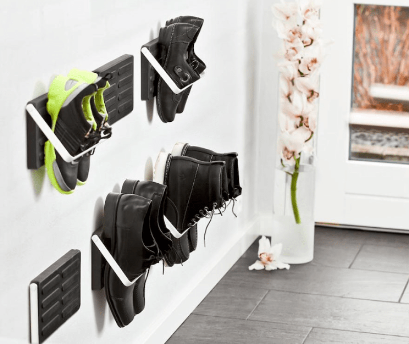 Organized closets // how to organize your shoes // shoe storage ideas // extra storage // DIY shoe storage // small space storage solutions // entryway shoe hooks // www.SimplySpaced.com