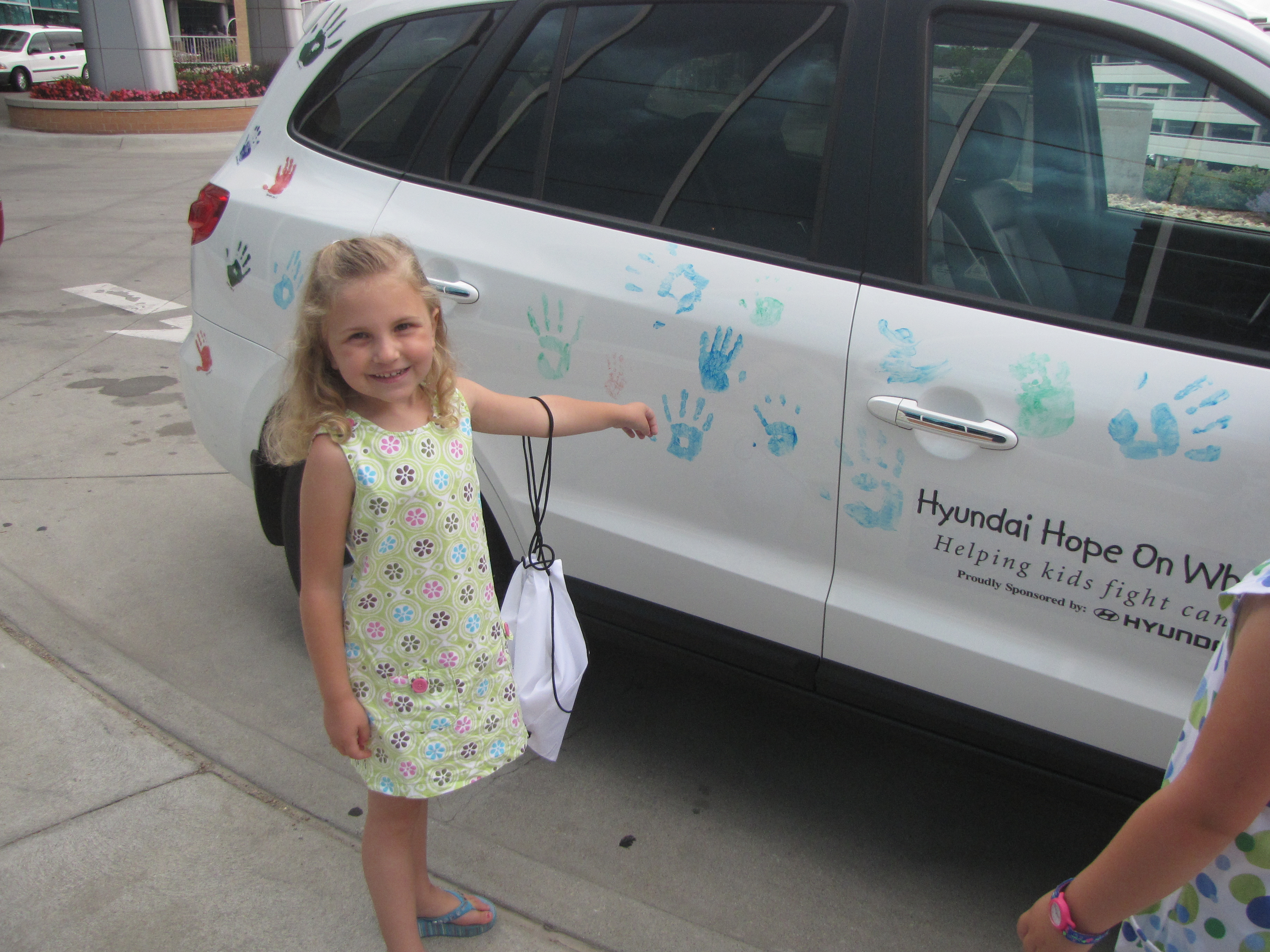 Sydney with her handprint at Hyundai Hope On Wheels