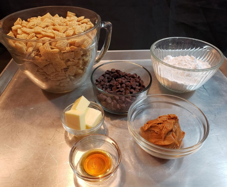 The ingredients for Muddy Buddies on a tray