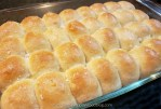 A pan of buttery Parker House Rolls sprinkled with Maldon sea salt