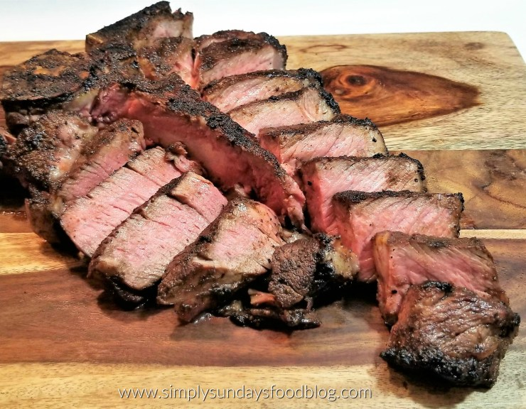 A porterhouse steak sliced on a cutting board
