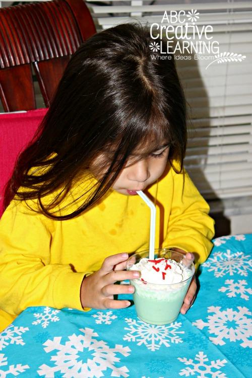 Enjoying Grinch Christmas Cookies and Green Shake
