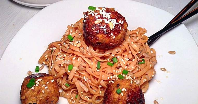 Sweet tofu and chickpea balls on rice noodles with peanut butter sauce