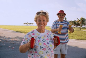 older couple walking with weights