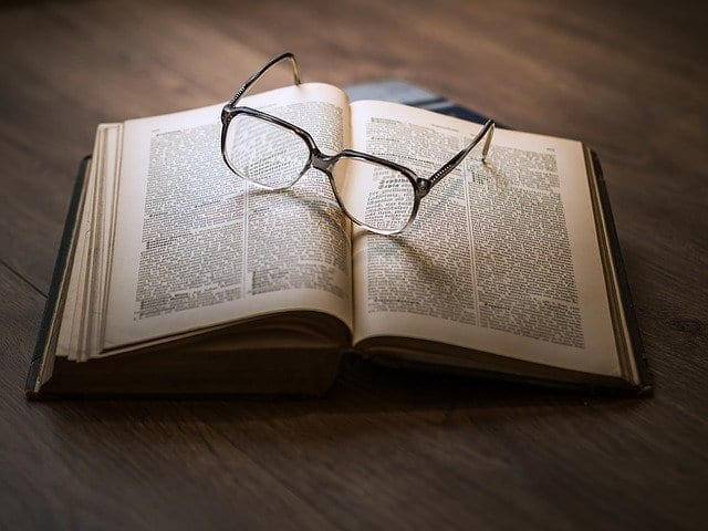 glasses on a book healthy tips for the new year