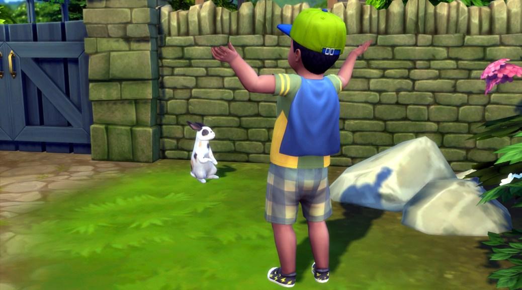 Robert the toddler talks to a rabbit