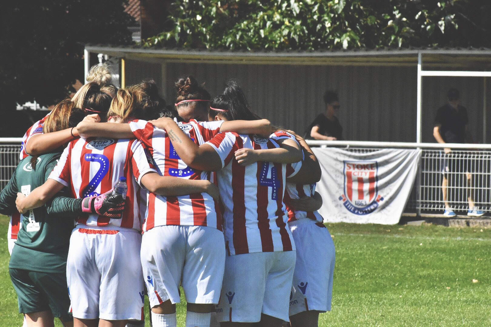 Stoke City Ladies huddle together for a pre match pep talk.