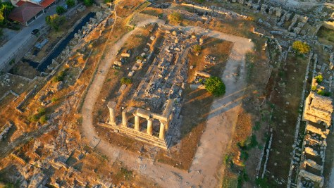 Aerial drone photo of the iconic archaeological site of Ancient Corinth built in the slopes of Acrocorinth, Peloponnese, Greece