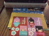 Justine sent Jenn books and stickers.