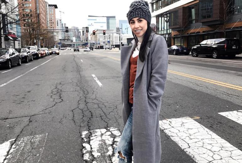 street photo, beanie, wardrobe-must-have turtleneck layered under strappy tank, duster coat, boyfriend jeans