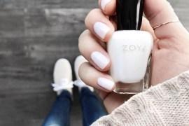 "manicure in off-white, Zoya's ""Adel,"" blue jeans, canvas sneakers, beige sweater, burgundy bomber sleeve"