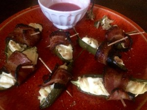 Jalapeno poppers wrapped in Reid's homemade smoked maple bacon
