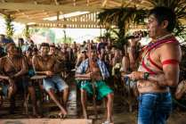"""Within the Mundurku political system, each village has a chief and a warlord. The general chief of the Munduruku people, Arnaldo Kaba, tells an audience of 90 fellow chiefs that decisions have to be made about the dams. Decisions are made by means of consensus and everyone has a voice. """"Failure of the Munduruku people is if it is divided"""", says chief Juarez Saw of the village Sawré Muybu. Sawré Muybu would be flooded if the government were to put these planned dams in effect."""