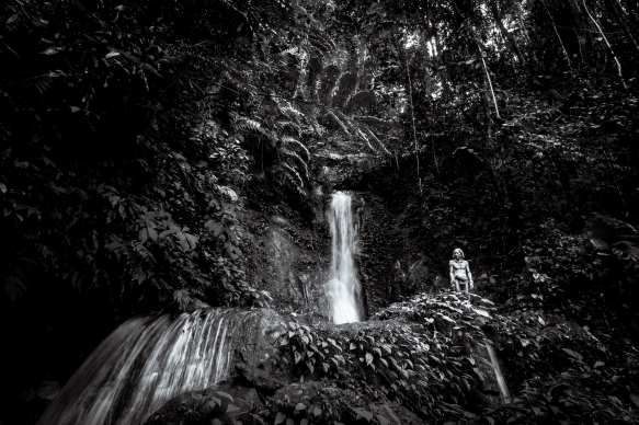 The Jungle: Siberut Island, Mentawai, Indonesia. Mentawai tribesman and Sikerei (Shaman) Amun Masit Dere stands amid the tropical rainforest deep in the Sarereiket regions of Siberut Island. Photograph by Chris Hopkins © Chris Hopkins 2017
