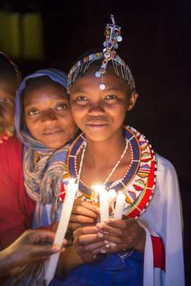 Maasai Girls Holding a Candle