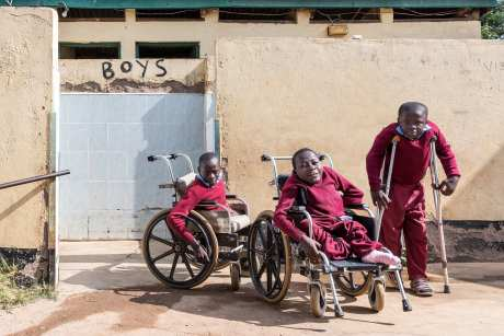 Young boys posing during their recess. Most of the children here are disabled, some of them mentally but most of them suffer from spina bifida which leads to difficulties walking or to being paralyzed from the waist down.