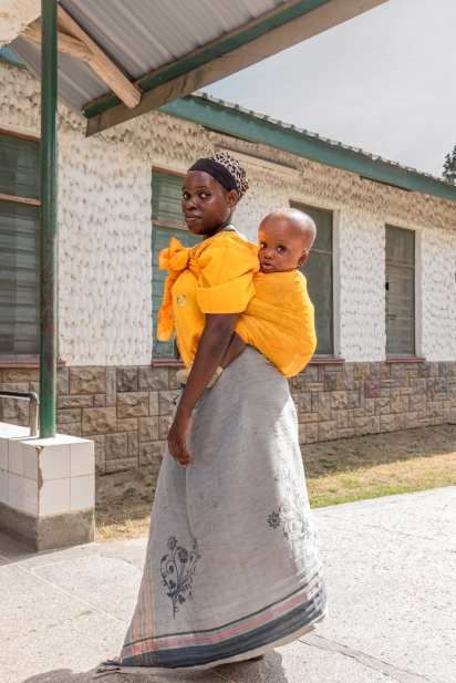 A mother from Tana River dropping off her child here for the first time. Because she lives with a tribe and there\'s a lot of stigma surrounding children with disabilities she deemed it safer for the child to be here at the boarding school. A lot of the children here were brought over by relatives because some members of the tribe might actually want to kill them, saying children with disabilities bring bad luck. Purity Karuga, head of the school is disabled herself and was brought here by her uncle when she was young because her parents tried to drown her in a well. She knows what the story is and now organizes sessions with the parents to make them better understand the condition of their child.