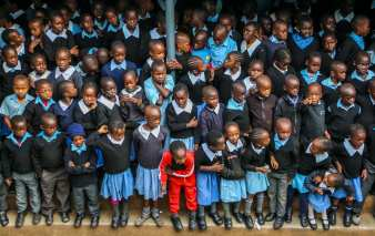 Friday morning, pupils from Joysprings Educational Centre stand on their assembly grounds for prayers, spiritual advice and weekly insights from their teachers. February 26, 2016. © Brian Otieno