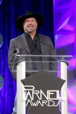 ANAHEIM, CALIFORNIA - JANUARY 17: Garth Brooks speaks onstage at The 2020 NAMM Show on January 17, 2020 in Anaheim, California. (Photo by Jesse Grant/Getty Images for NAMM)