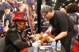 ANAHEIM, CALIFORNIA - JANUARY 18: Bootsy Collins (L) greets fans at The 2020 NAMM Show on January 18, 2020 in Anaheim, California. (Photo by Jesse Grant/Getty Images for NAMM)