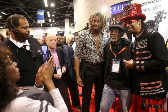 ANAHEIM, CALIFORNIA - JANUARY 18: Uche Ndubizu (L) and Bootsy Collins (R) attend The 2020 NAMM Show on January 18, 2020 in Anaheim, California. (Photo by Jesse Grant/Getty Images for NAMM)