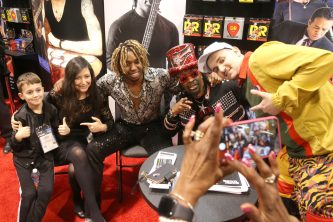 ANAHEIM, CALIFORNIA - JANUARY 18: Uche Ndubizu (CL) and Bootsy Collins (CR) greet fans at The 2020 NAMM Show on January 18, 2020 in Anaheim, California. (Photo by Jesse Grant/Getty Images for NAMM)