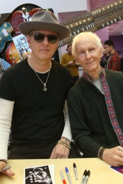 ANAHEIM, CALIFORNIA - JANUARY 18: Robby Krieger (R) attends The 2020 NAMM Show on January 18, 2020 in Anaheim, California. (Photo by Jesse Grant/Getty Images for NAMM)