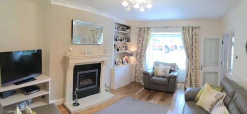 Sitting room redeisgn with bespoke built in's, leather sofa, new fireplace, curtains and lighting