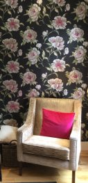 Sitting room redesign- Dramatic floral wallpaper with black and magenta detail. Bespoke armchair from Mono.