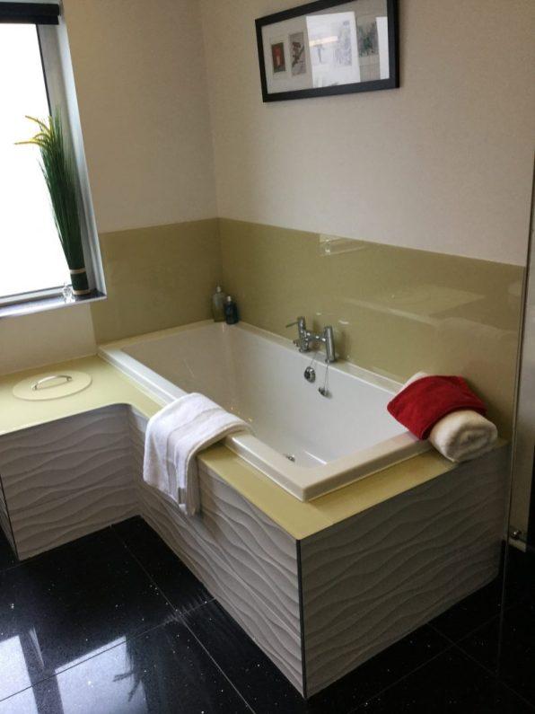 Bathroom design with laundry chute