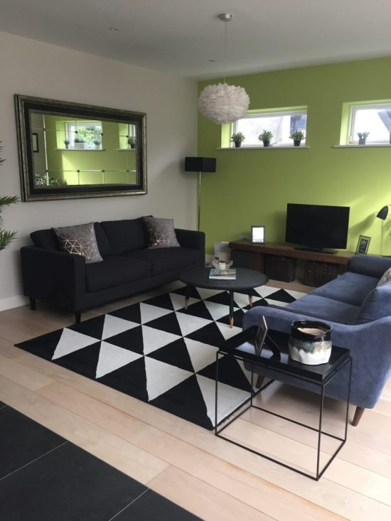 TV living area with contemporary green feature wall